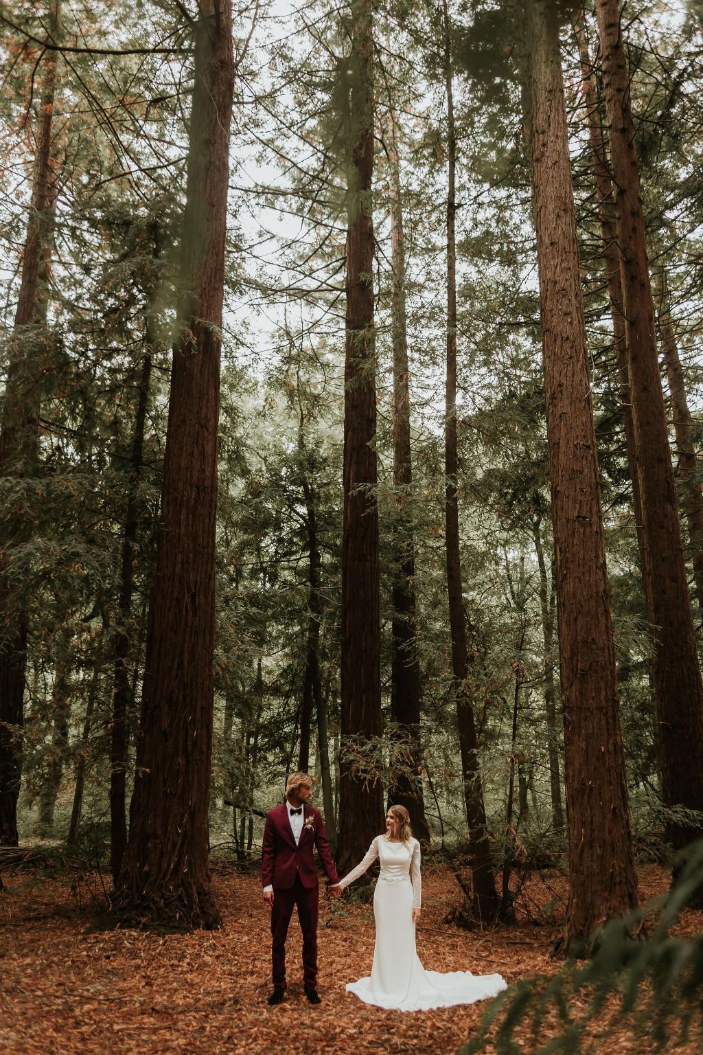 modern woodland wedding - autumn outdoor wedding - modern elopement photos - burgundy grooms suit and elegant wedding dress