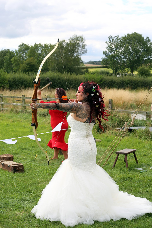 festival viking wedding - alternative wedding inspiration - unconventional wedding - alternative wedding blog - bride doing archery