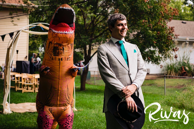 funny wedding first look - bride in trex costume - fun wedding ideas - unconventional wedding