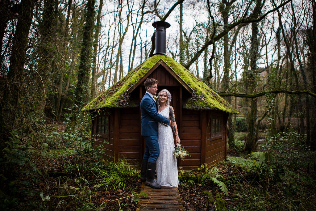 bride and groom in forest - bohemian wedding - winter elopement - simple wedding - pandemic wedding - small wedding - unconventional wedding