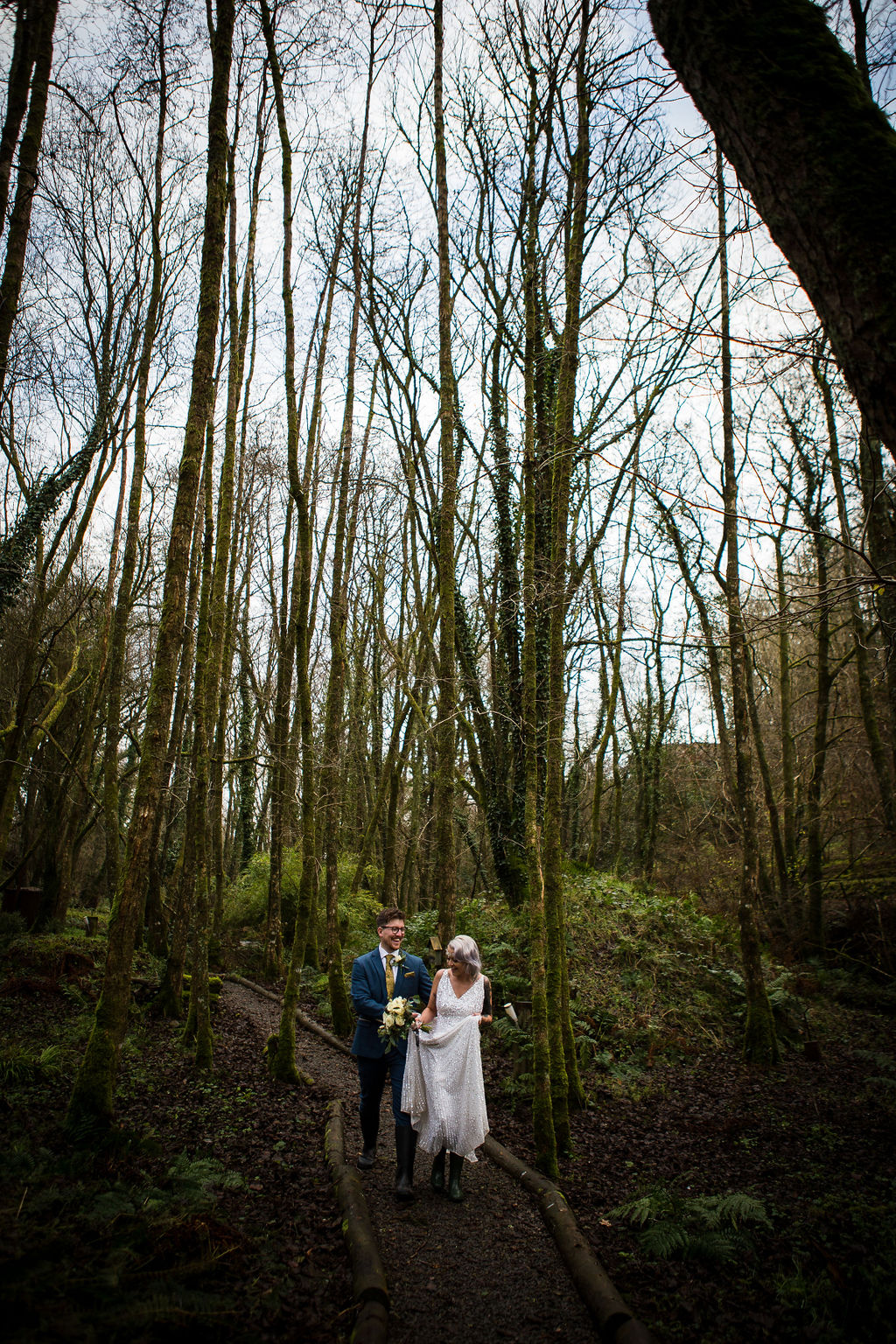 winter elopement - simple wedding - pandemic wedding - small wedding - unconventional wedding - bride and groom in forest