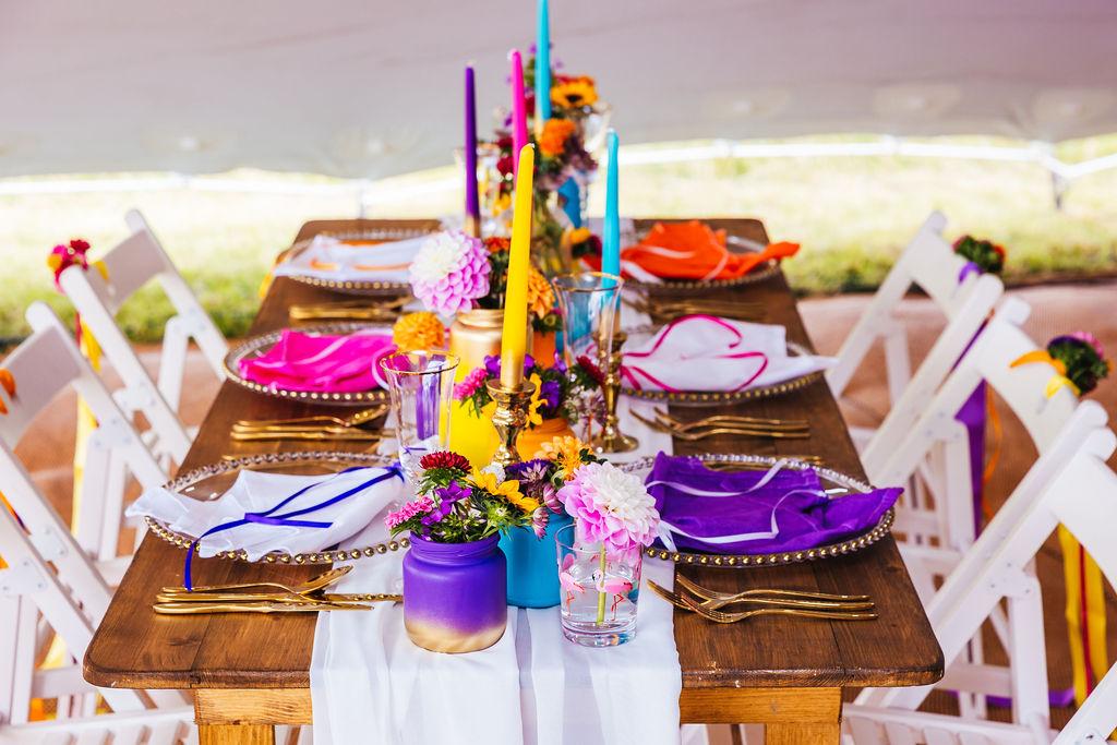 bright festival wedding - colourful wedding table styling - colourful wedding candles - colourful wedding styling - unique wedding styling - quirky marquee wedding