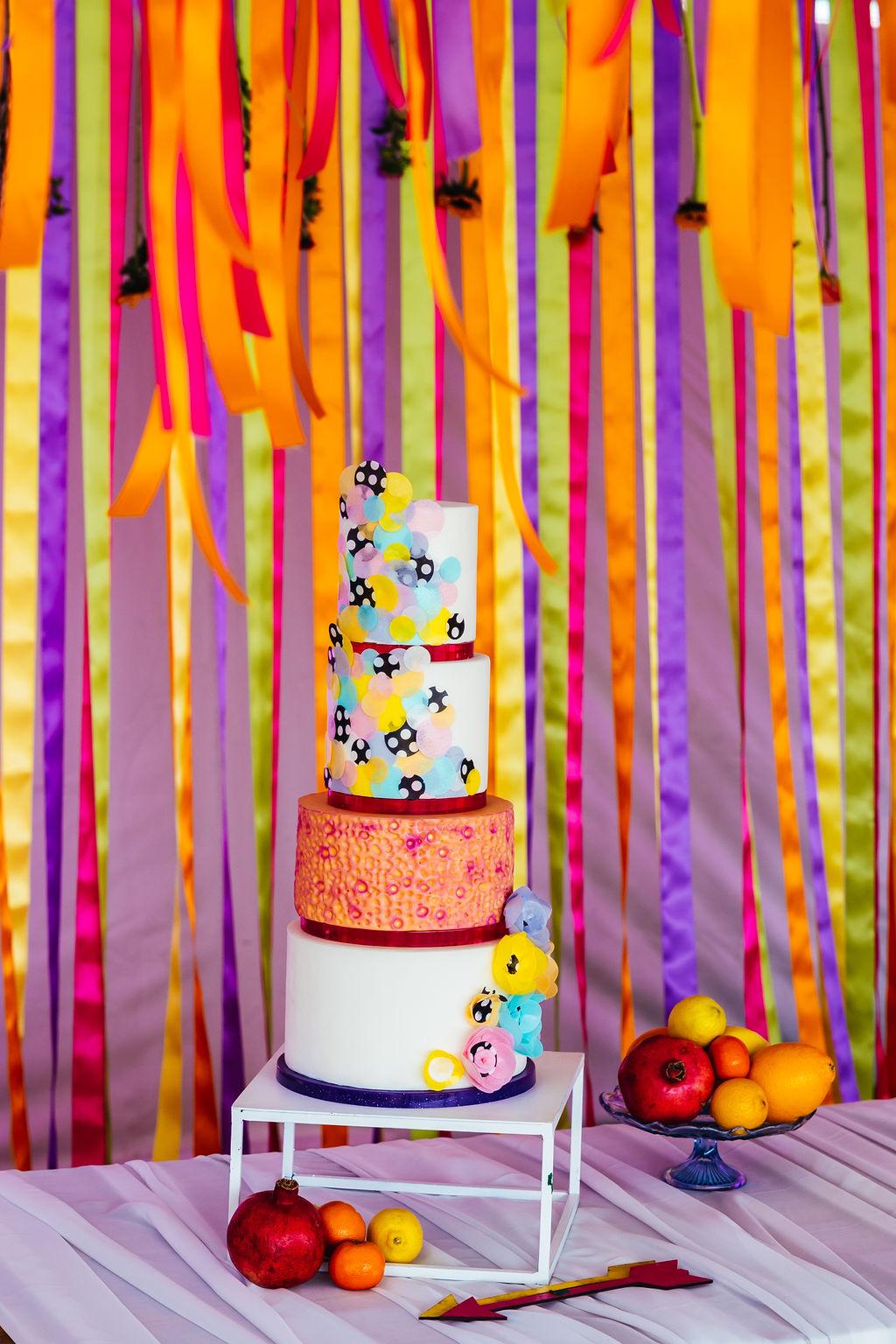 bright festival wedding - colourful wedding cake - rainbow wedding cake - funky wedding cake - rainbow wedding ideas