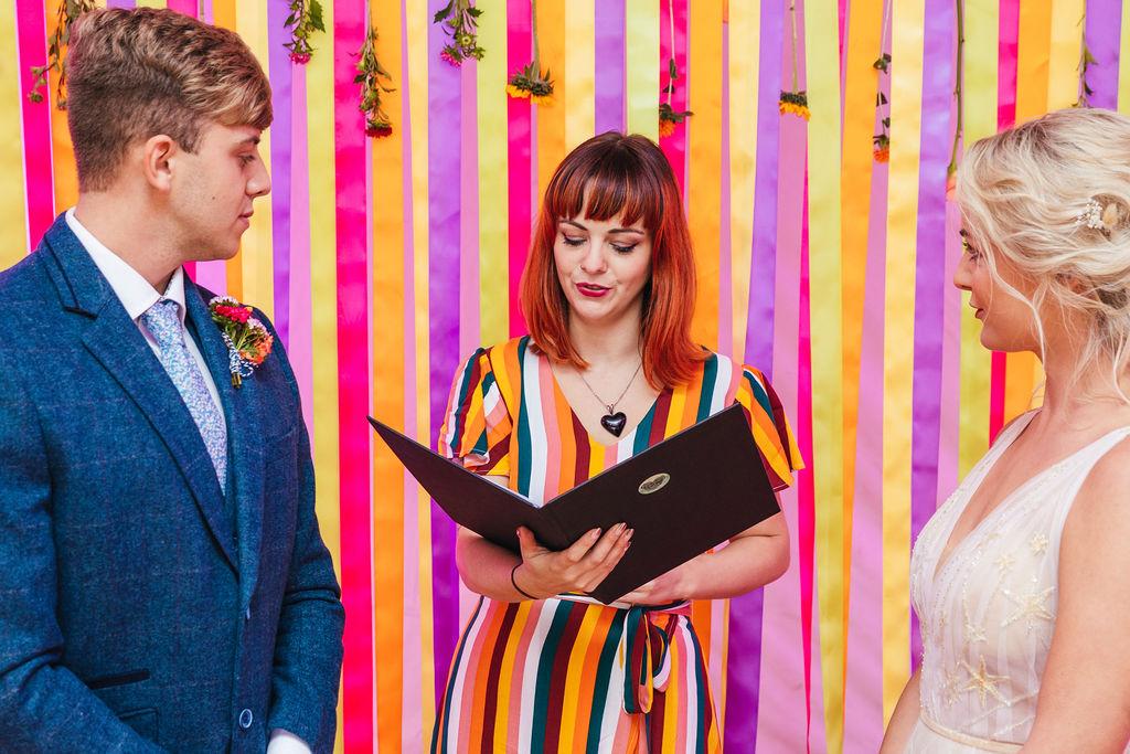 bright festival wedding - colourful wedding - colourful wedding backdrop - celebrant wedding ceremony