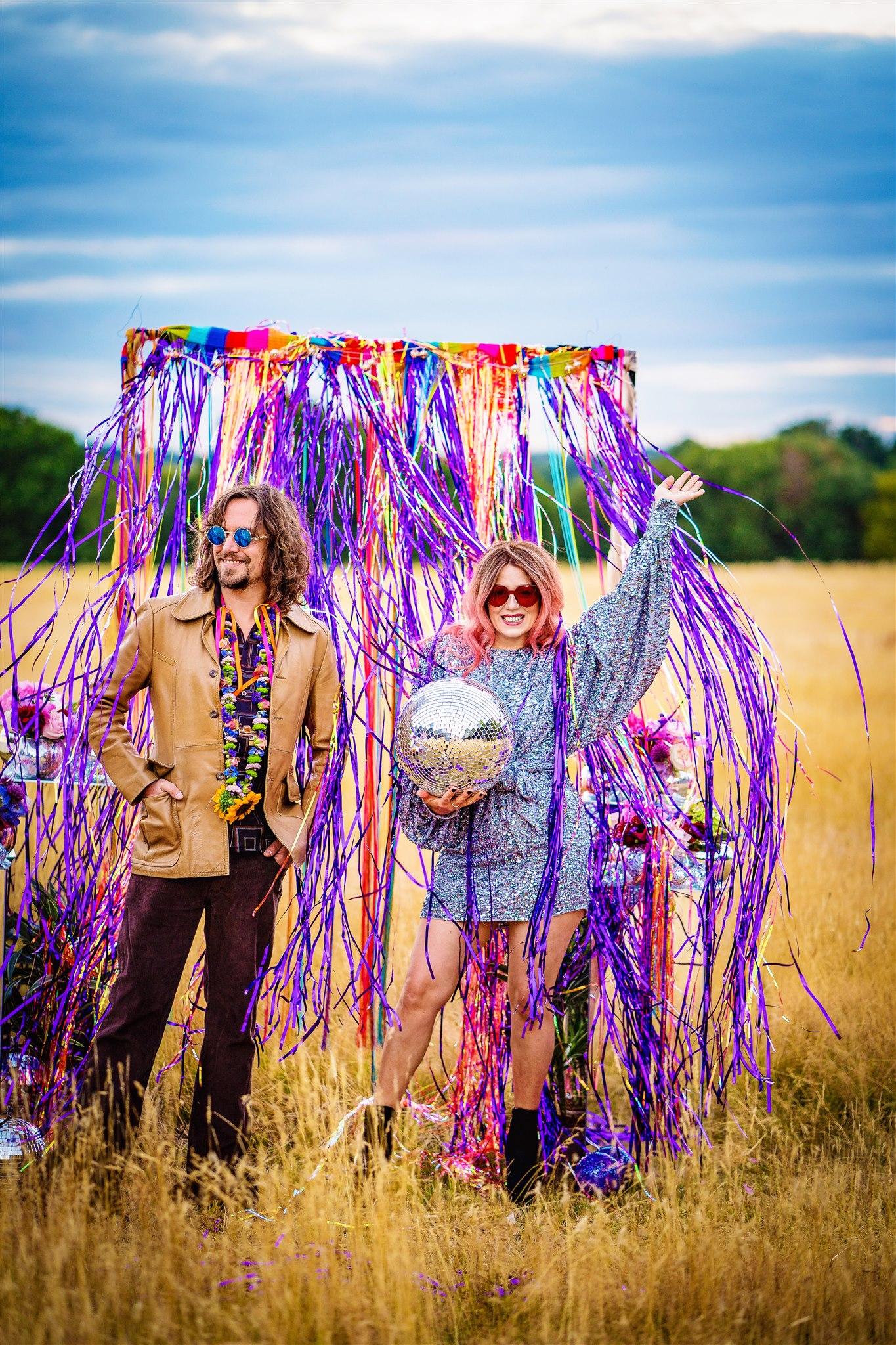 colourful bohemian wedding - 70s wedding - campervan wedding - hippie wedding - colourful wedding backdrop