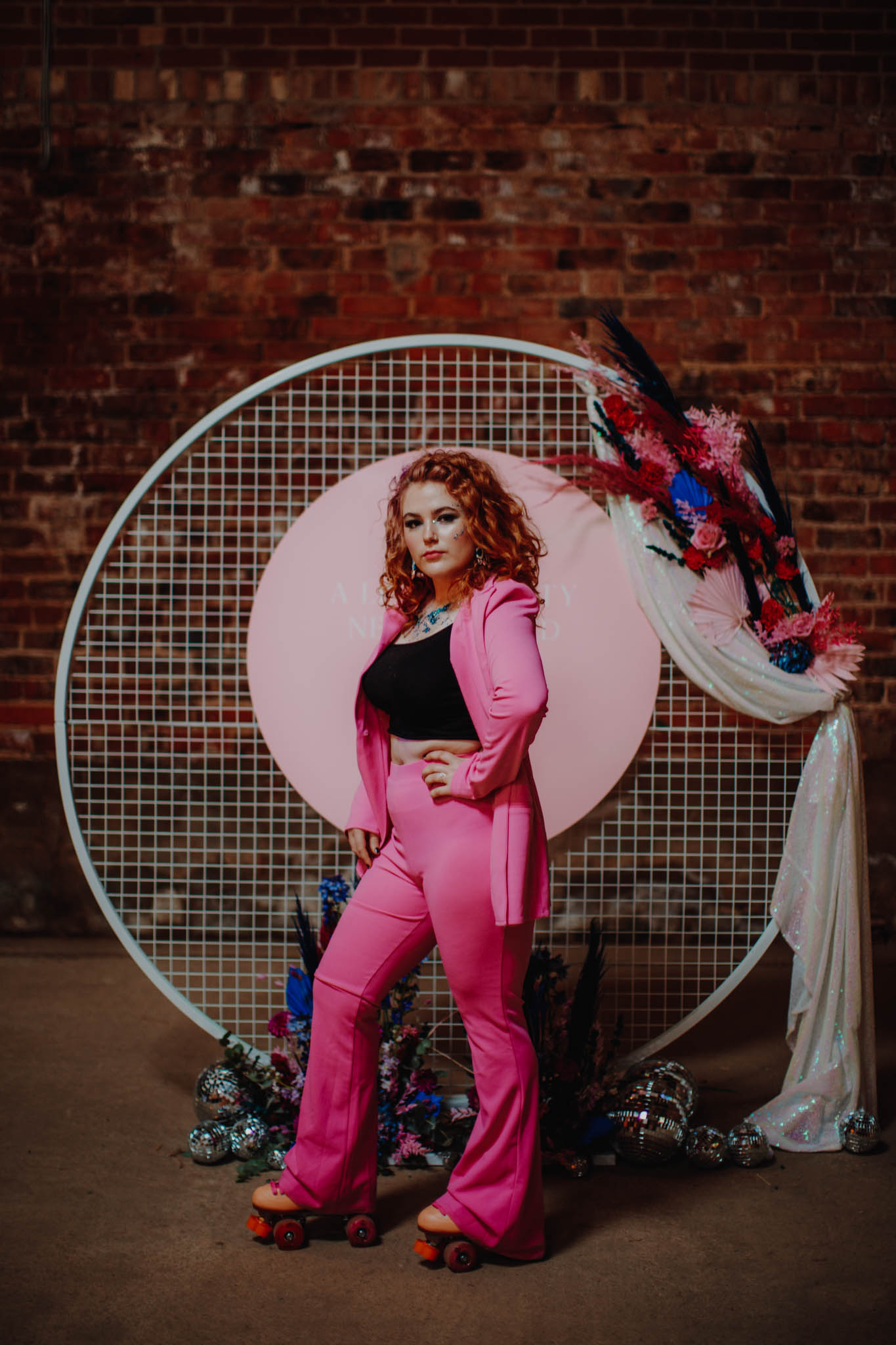roller disco wedding - 80s wedding - bridal suit - hot pink bridal suit - alternative bridal wear