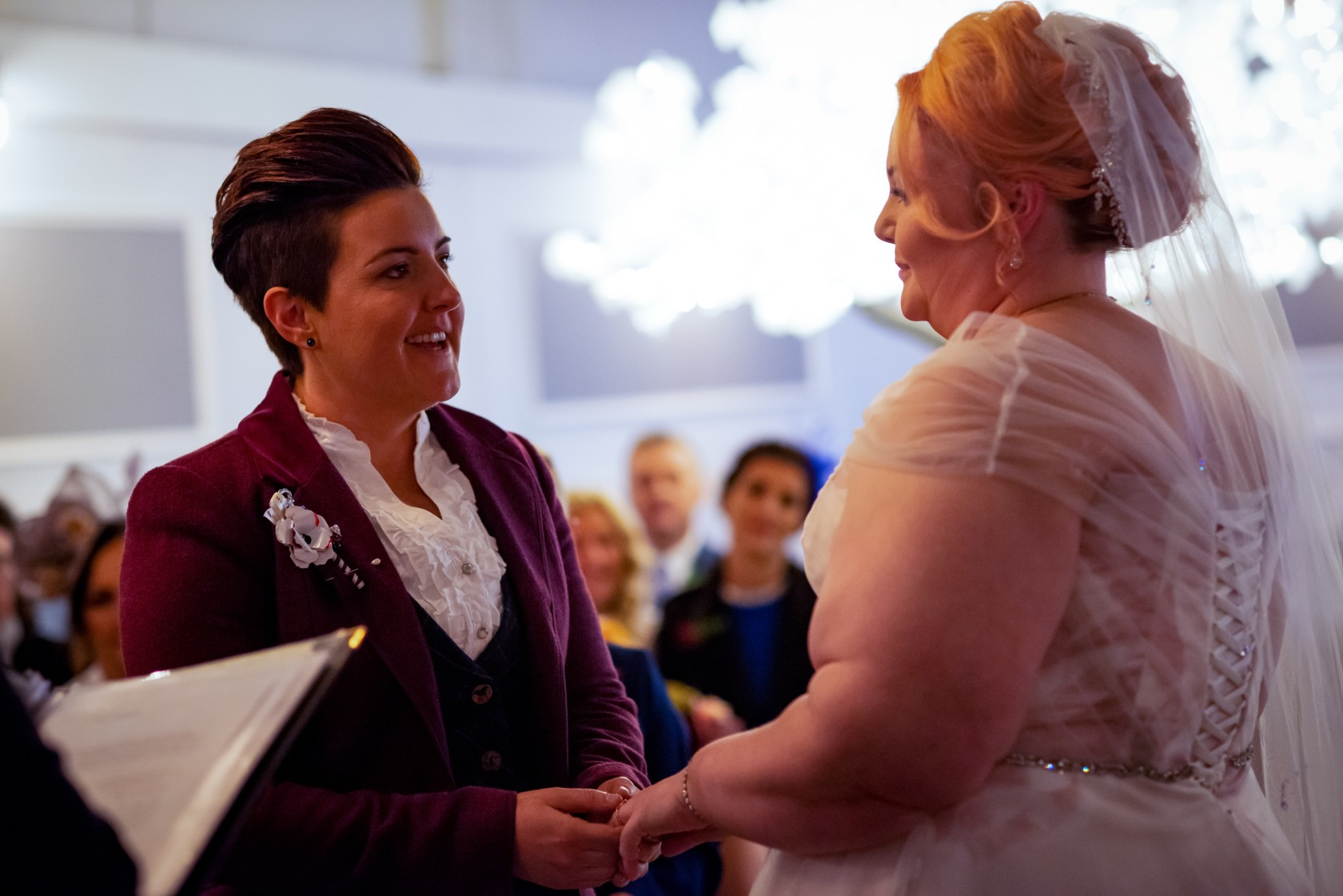 brides saying vows - wonderland wedding - real wedding inspiration - DIY wedding - romantic wedding - same sex wedding - lgbtq wedding - unconventional wedding