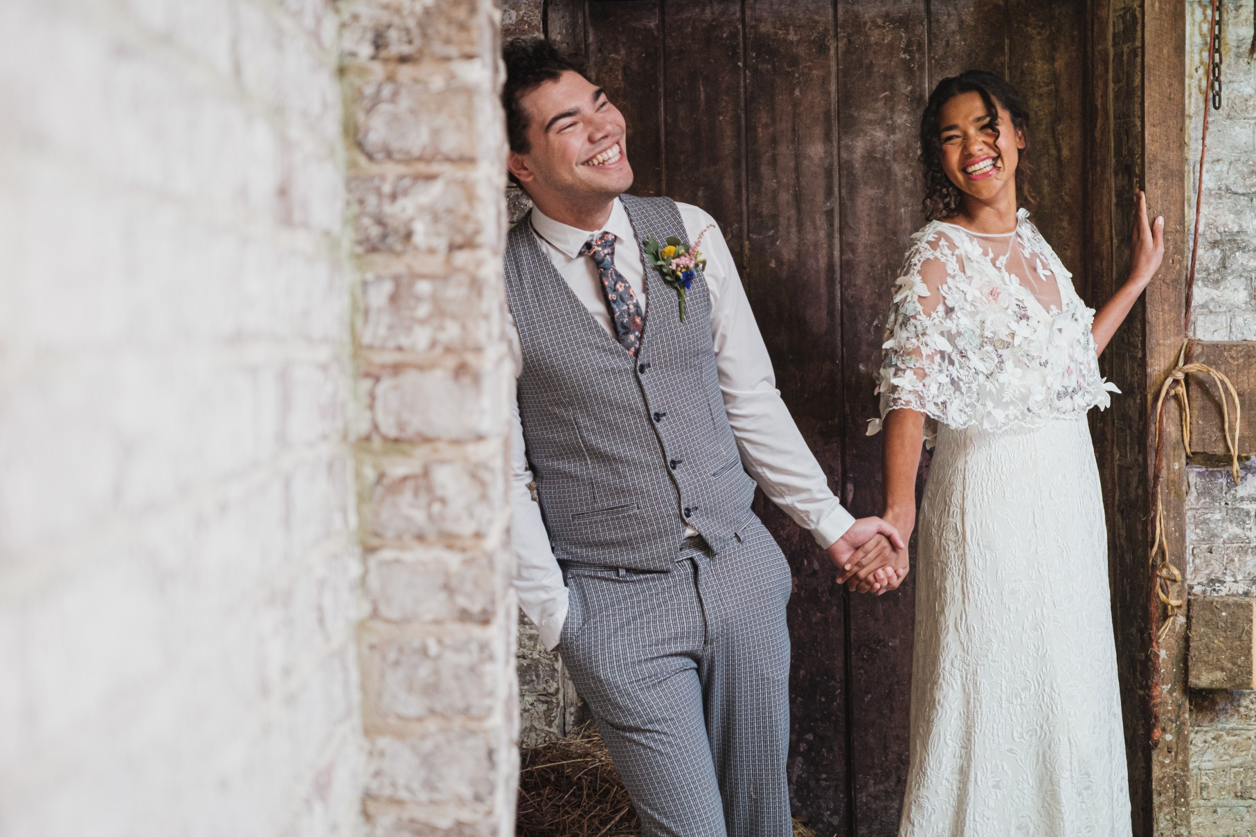bride and groom laughing - unique bridal wear - unique grooms wear - unconventional wedding