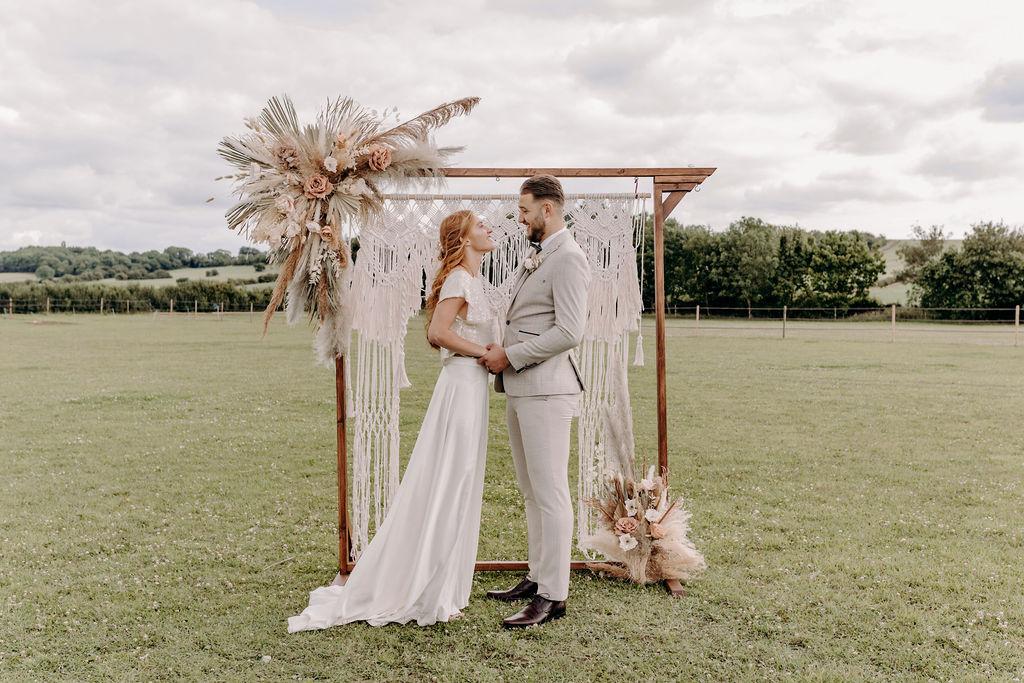 sustainable boho wedding - bohemian wedding - outdoor micro wedding - bohemian elopement - macrame backdrop
