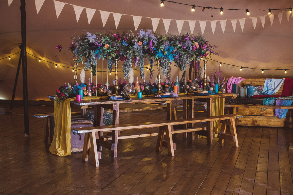 colourful wedding flowers - colourful wedding cake - festival wedding flowers - hot pink wedding cake - colourful festival wedding decor - bold wedding flowers - bohemian wedding table decor