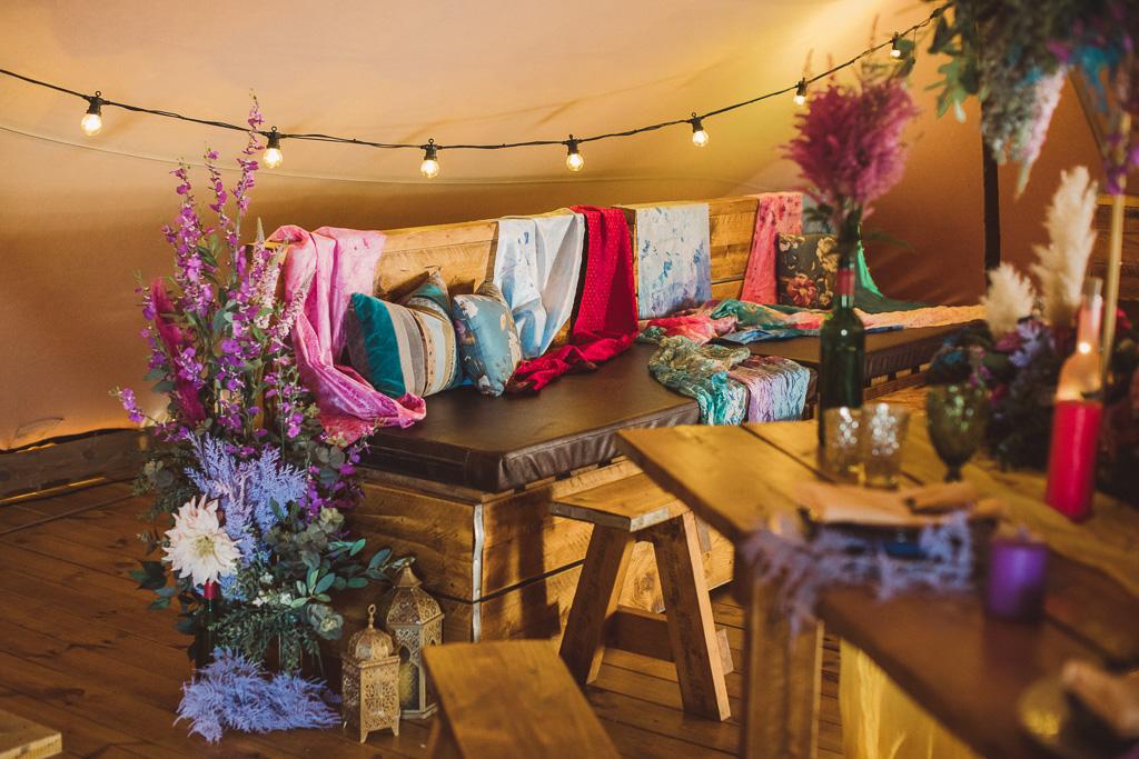 festival wedding seating area - tipi wedding - bohemian wedding - colourful wedding ideas