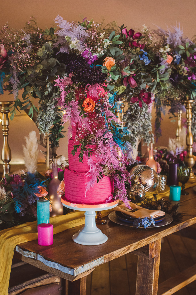 colourful wedding flowers - colourful wedding cake - festival wedding flowers - hot pink wedding cake - colourful festival wedding decor - bold wedding flowers