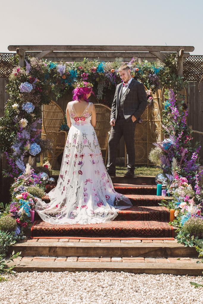 colourful wedding flowers - alternative dress - outdoor wedding ceremony- festival wedding flowers - unique wedding decor - alternative wedding - unconventional wedding