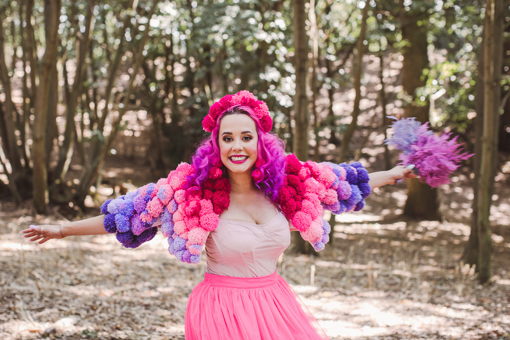 fun festival wedding - bridal pom pom jacket - pink bride - festival bride - coloured wedding dress - colourful wedding dress - bridal pom pom headdress - unconventional wedding - alternative bridal wear