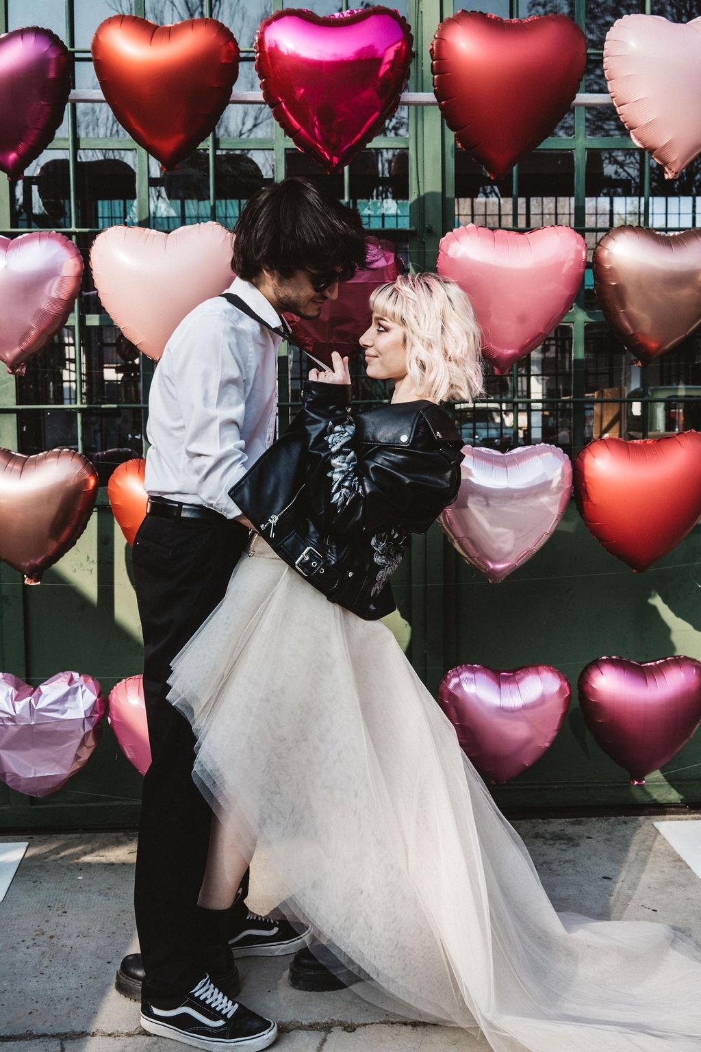 modern industrial wedding - alternative wedding - unconventional wedding - edgy wedding - funky wedding backdrop - heart shaped wedding balloons - alternative wedding balloons
