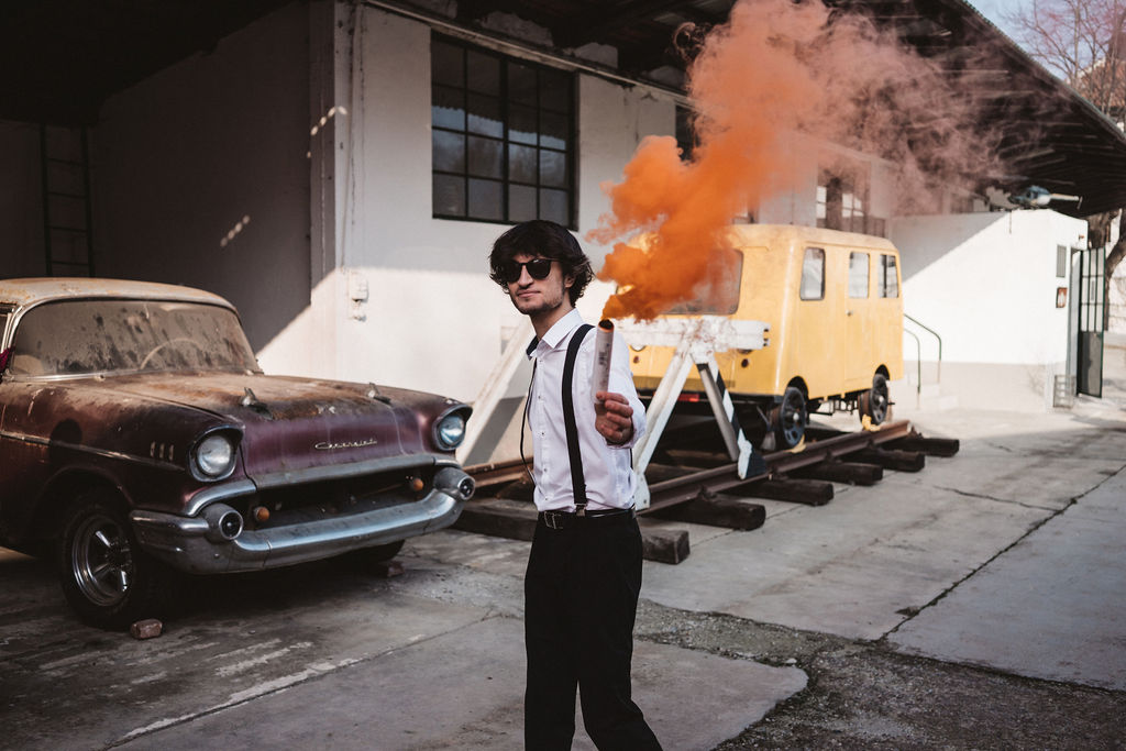 groom with smoke bomb - wedding smoke bomb - modern industrial wedding - alternative wedding - unconventional wedding - edgy wedding