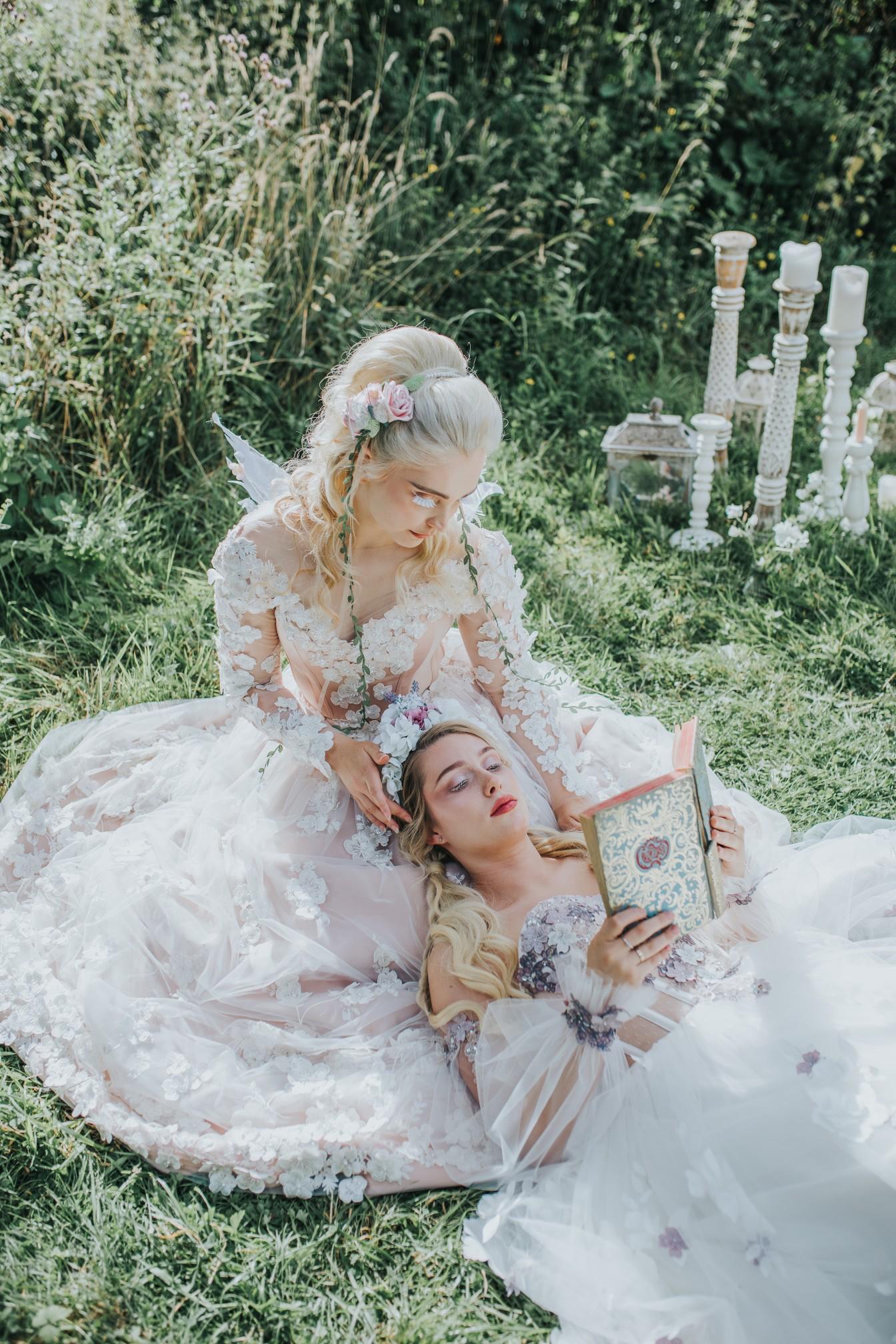 fairy wedding - whimsical wedding - magical wedding - elegant wedding dress - two brides sitting on grass