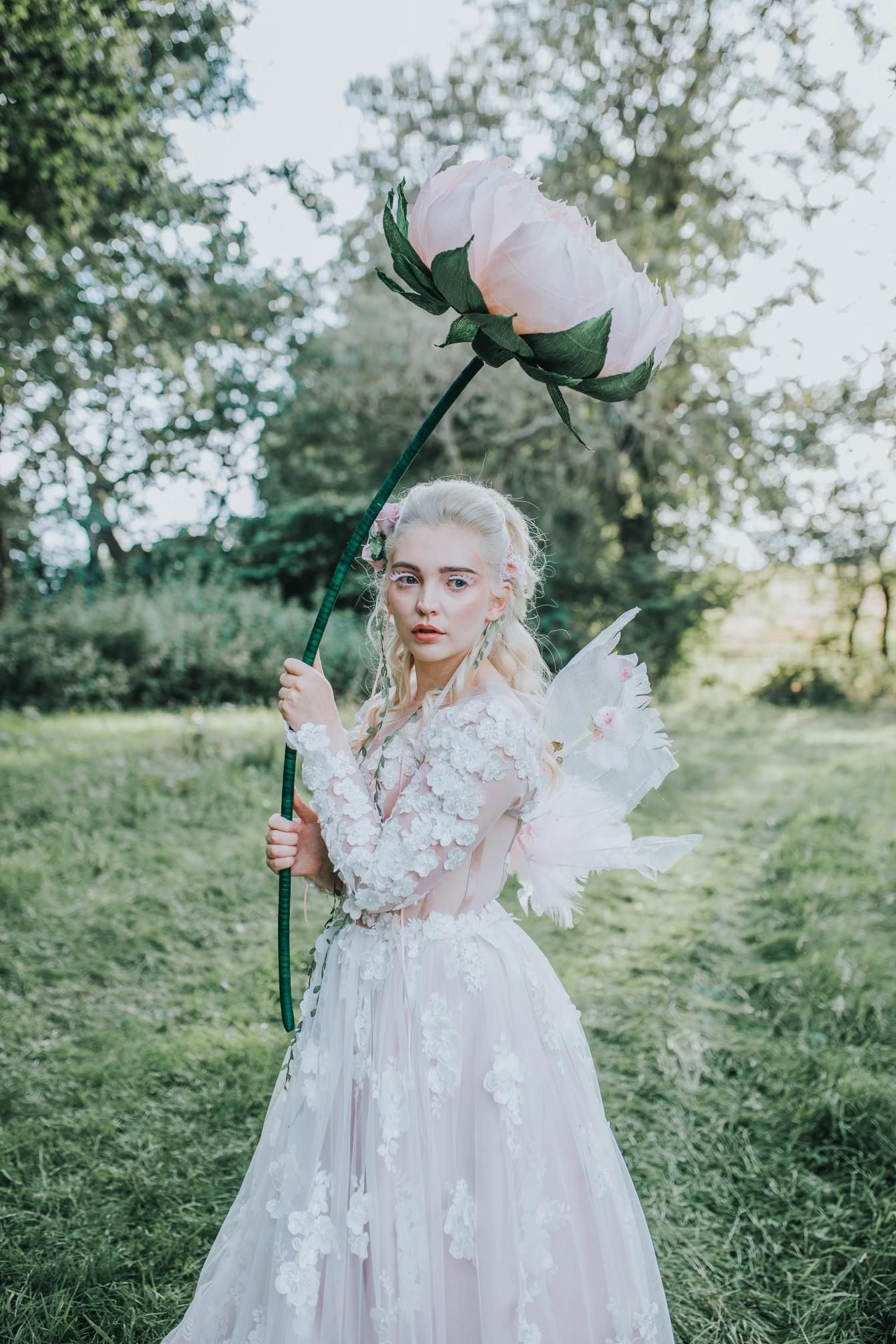 fairy wedding - whimsical wedding - magical wedding - elegant wedding dress - artistic wedding photos - large paper flower prop - fairy bride - creative wedding photos - wedding editorial