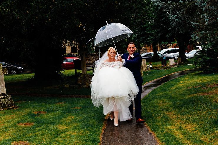 rainy wedding - rain wedding advice - fun wedding planning - wedding planning blog - rain wedding photos - bride and groom with umbrella