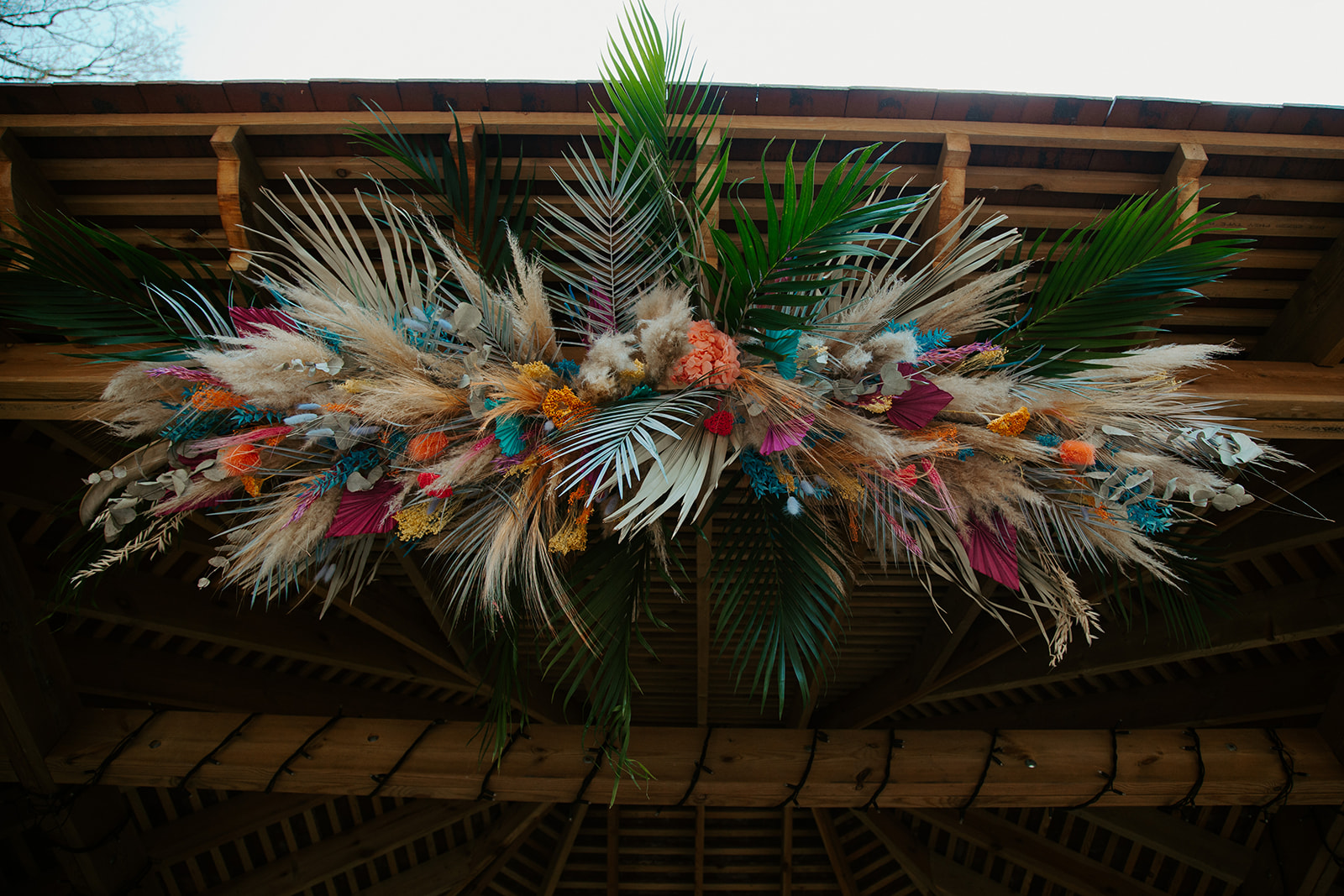 bold wedding flowers - dried wedding flowers - wedding flowers hanging - rainbow wedding flowers
