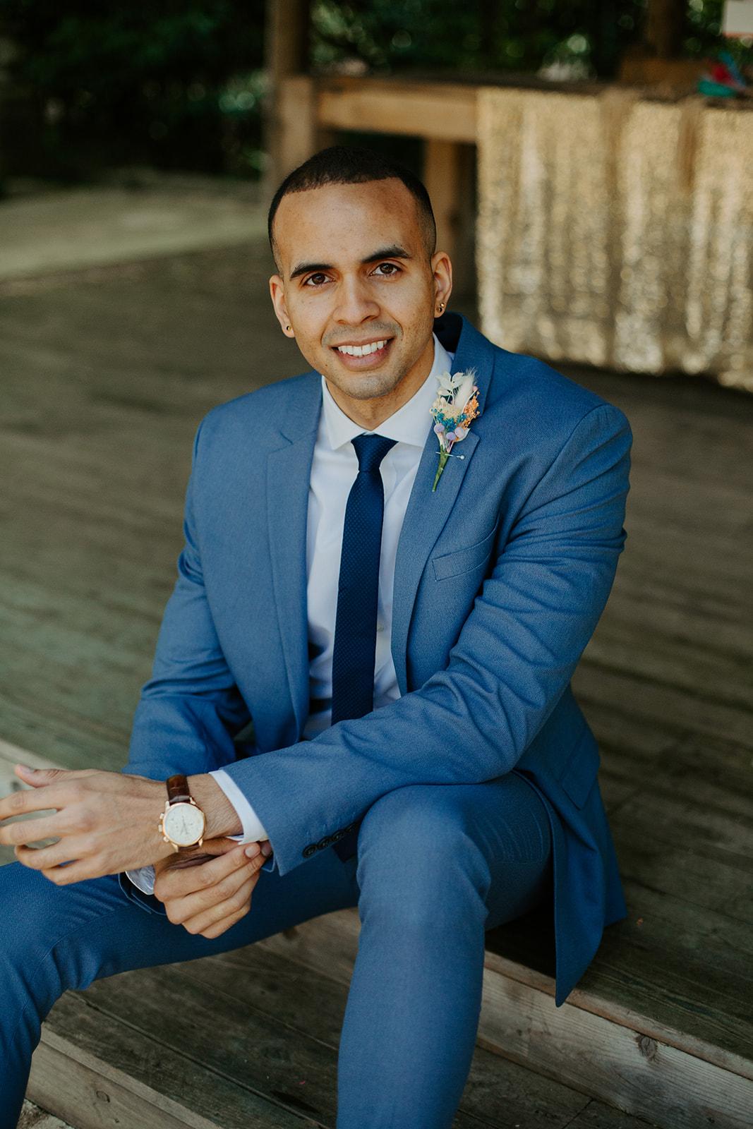 drive in wedding - camper van wedding - groom in blue suit