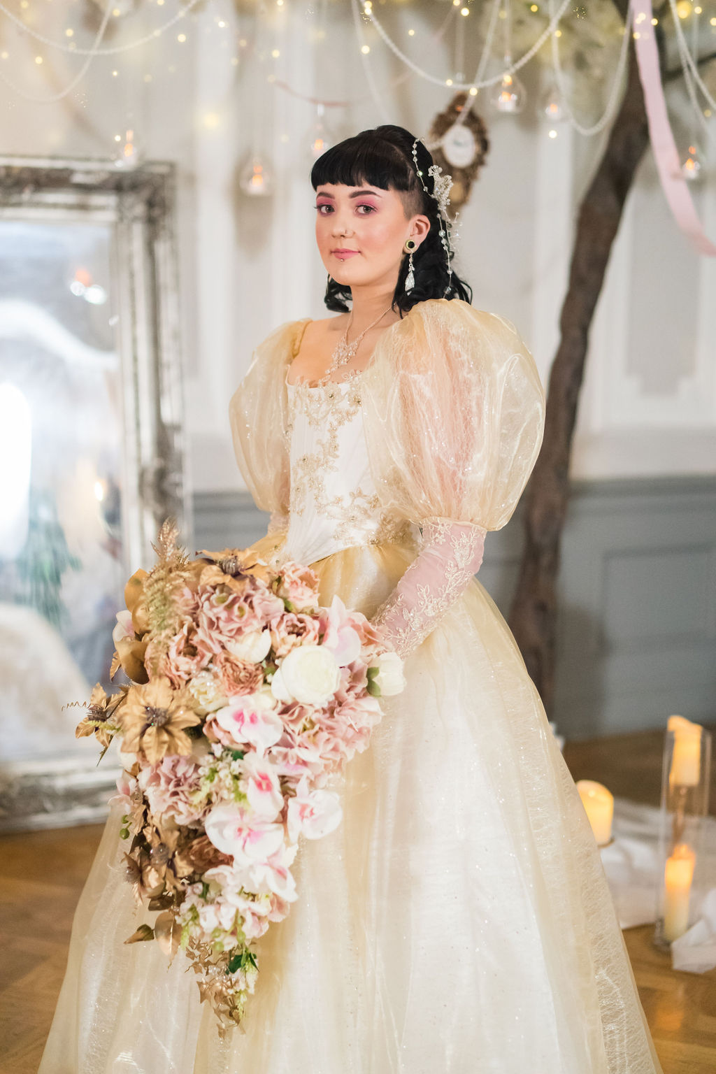 Fairytale bride with oversized dramatic bridal bouquet and princess wedding dress for labyrinth themed wedding day