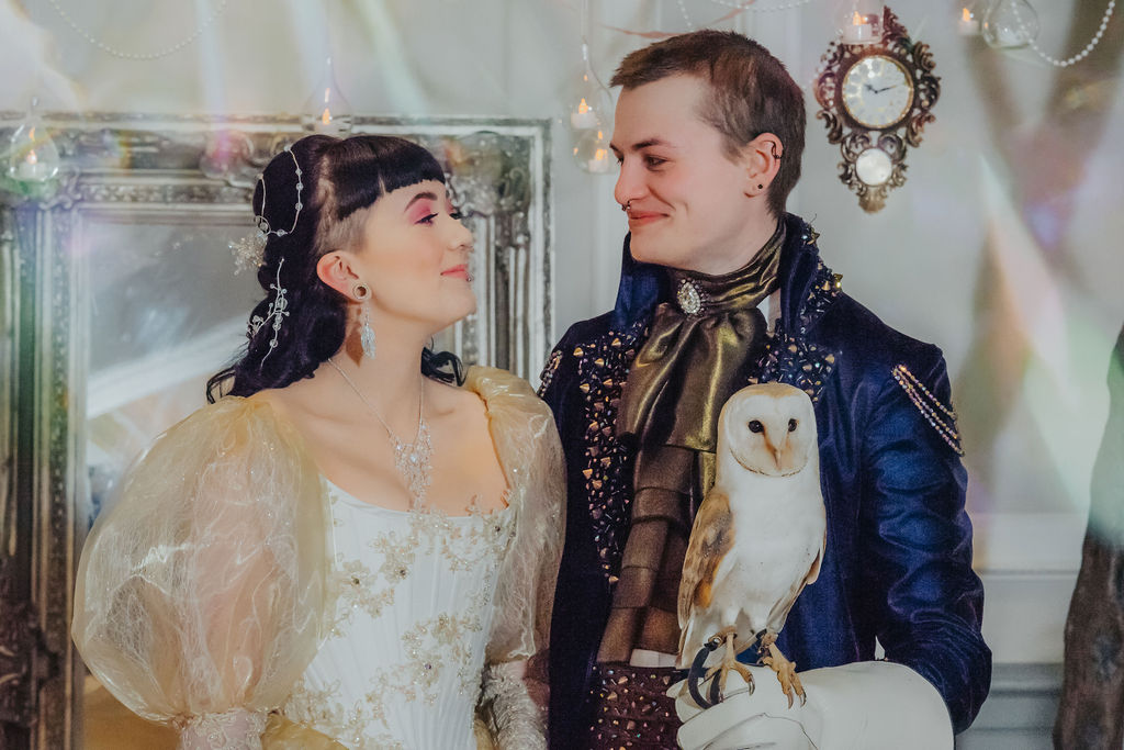Bride and Groom getting married with Owl in hand - Labyrinth themed wedding day 2 - quirky and alternative wedding days