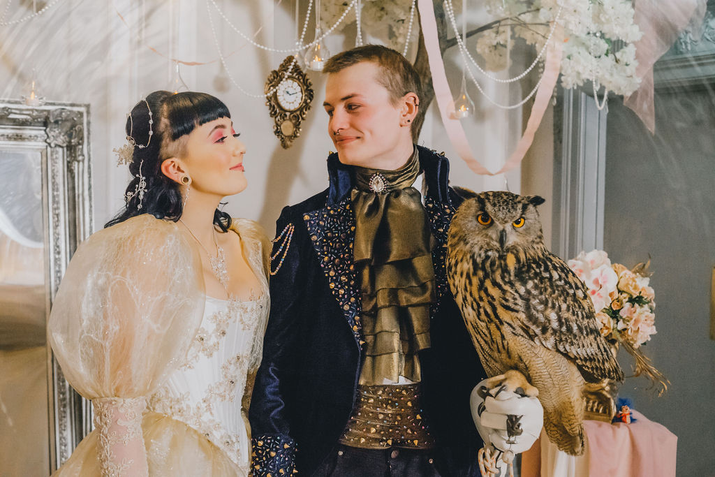 Bride and Groom getting married with Owl in hand - Labyrinth themed wedding day