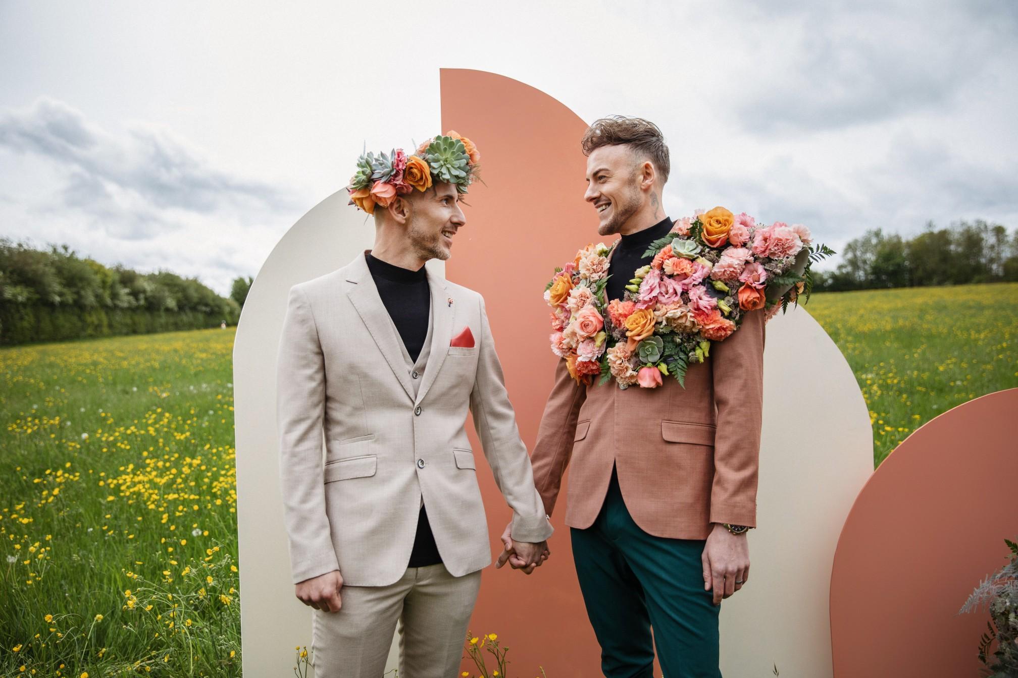 retro wedding backdrop - gay wedding ideas - groom in flower crown - unique wedding flowers - outdoor wedding ceremony