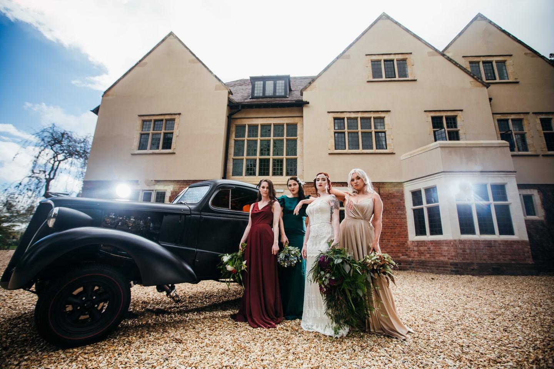 peaky blinders wedding - vintage wedding - 1920s wedding - themed wedding inspiration - vintage wedding car - fun bridesmaids photos