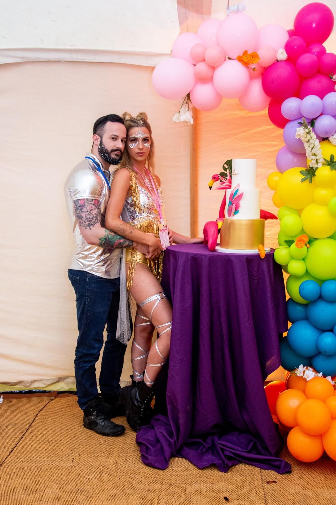 sparkly festival wedding - rainbow wedding balloons - colourful wedding balloons - festival wedding wear - unique wedding cake