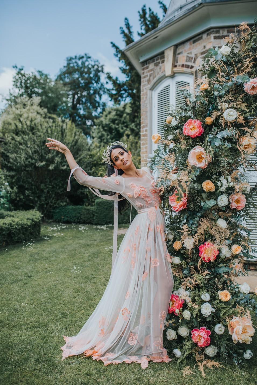 bridgerton wedding - regency wedding - whimsical wedding - wedding arch - wedding floral archway - vintage wedding - fairytale wedding dress - unique bridal wear - peach wedding dress - detailed wedding dress - unconventional wedding