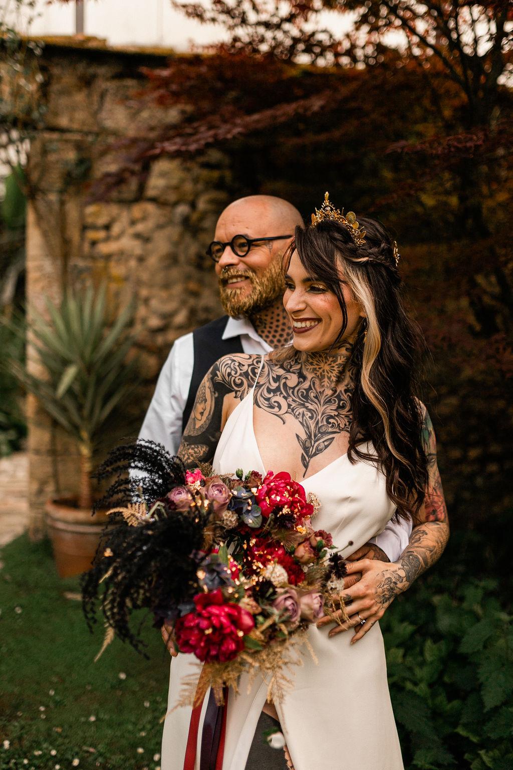 tattooed bride and groom - alternative wedding style - alternative wedding bouquet
