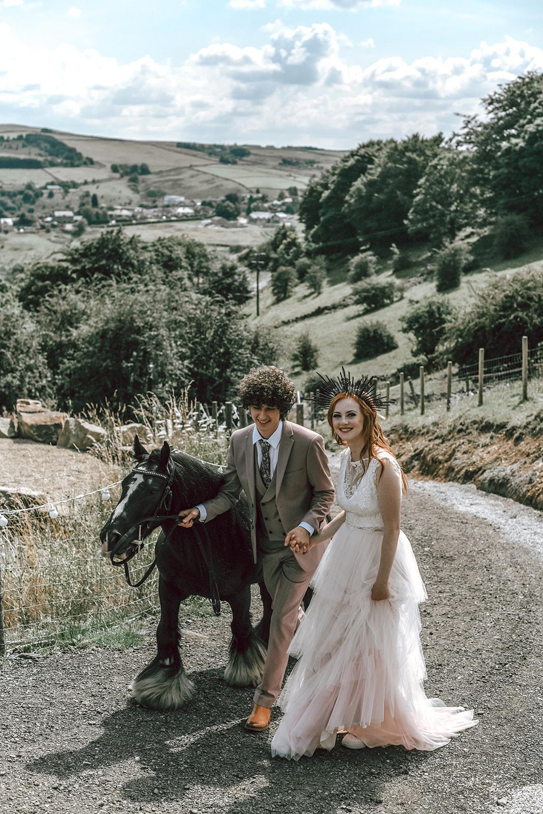 rustic festival wedding - farm wedding - bride and groom with horse