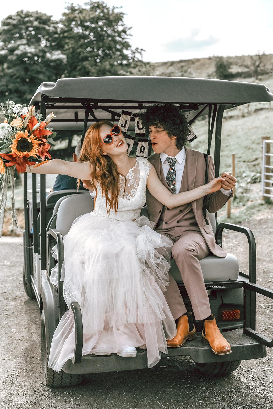 rustic festival wedding - bride and groom in golf buggy - fun boho wedding