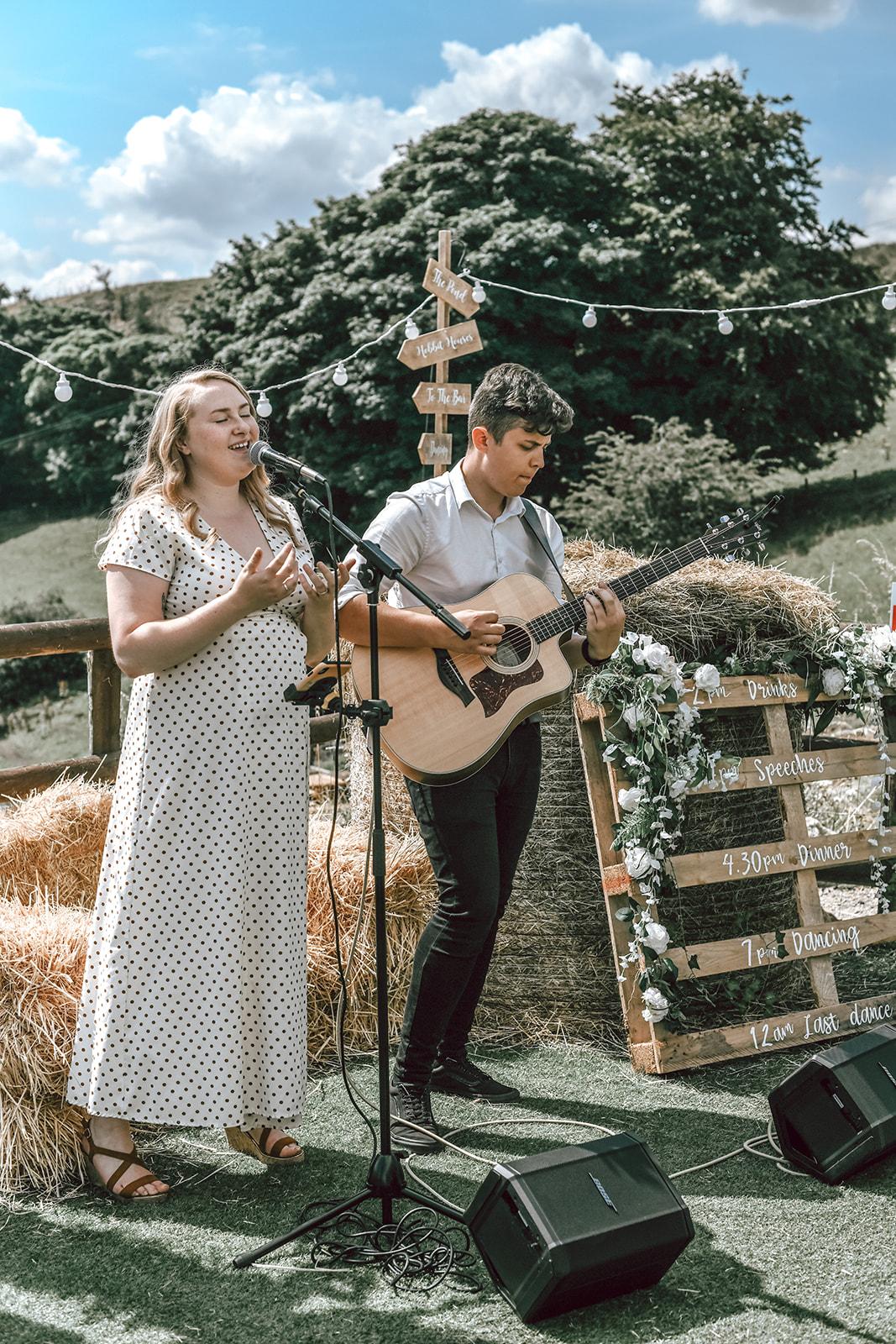 rustic festival wedding - unique wedding entertainment - wedding duo - acoustic duo for weddings - festival wedding entertainment