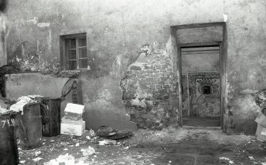 Madonna painted in a recess of a courtyard full of trash and broken down walls, Kazimierz 1992