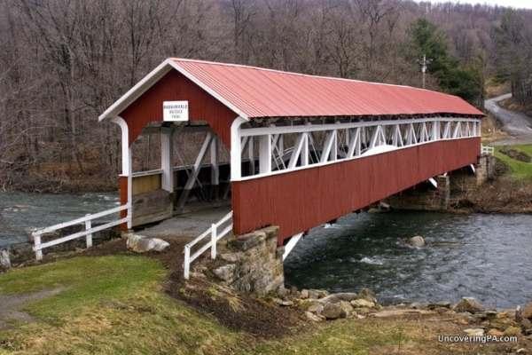 The beautiful Barronvale Covered Bridge near Cole Run Falls in Somerset County, Laurel Highlands.