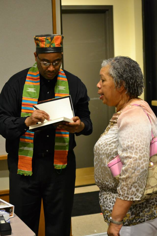 """Adrian Miller dressed for the hip hop floor of the """"Soul Food"""" book launch 8/17/2013, Blair-Caldwell African American Research Library, Denver"""