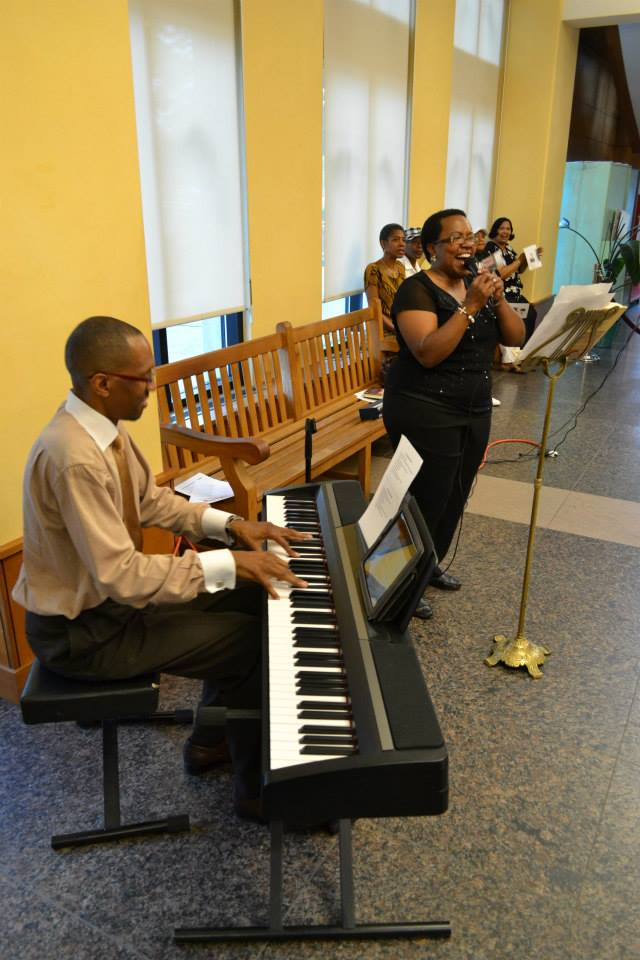 "Robertta F. Johnson Moore and Michael Williams keeping the first floor folks entertained. Adrian Miller ""Soul Food"" book launch party, Denver Public Library 8/17/2013"