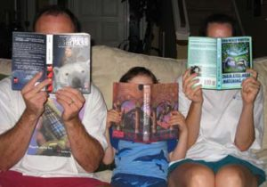 A UNC Press family reading The Golden Compass, Harry Potter, and Their Eyes Were Watching God