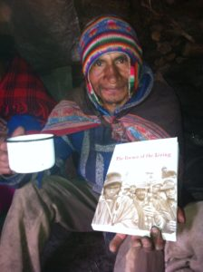 "Narciso Huamán with the book, ""The Corner of the Living."""