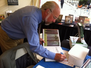 Bill Finch signs another copy of Longleaf, Far As the Eye Can See