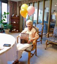 Maggie Talbert on her 101st birthday with a copy of Grandfather Mountain