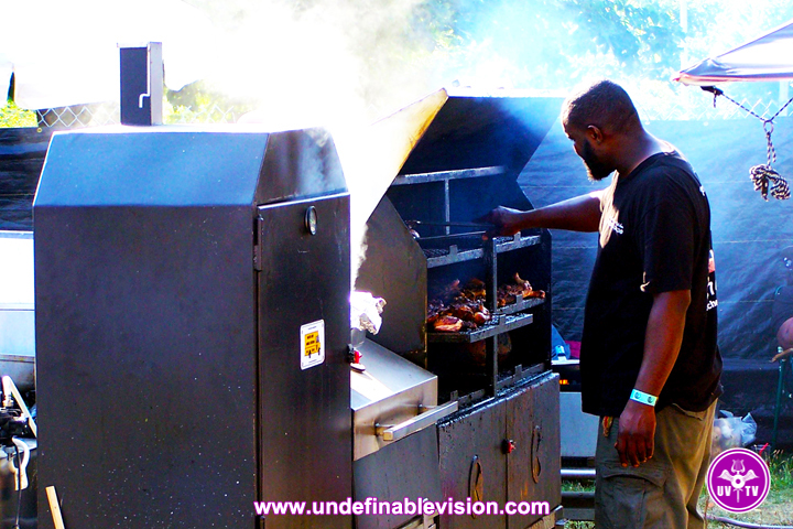 Food Vendor cooking up delicious Jerk food at the Grace Jamaican Jerk Festival New York - Undefinable Vision