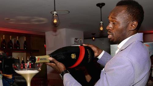 Usain Bolt Pouring Mumm Grand Cordon