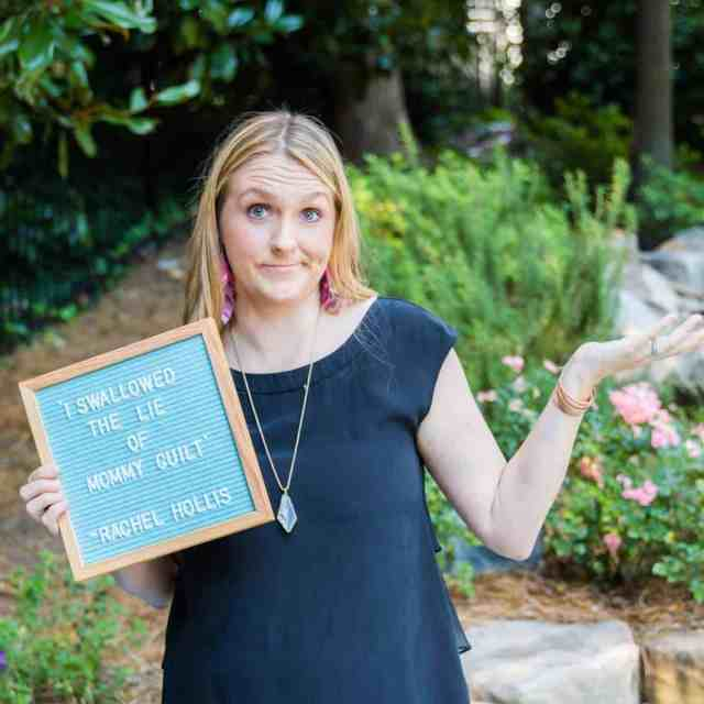 blonde woman shrugging her shoulders holding a letter board that says I swallowed the lie of mommy guilt