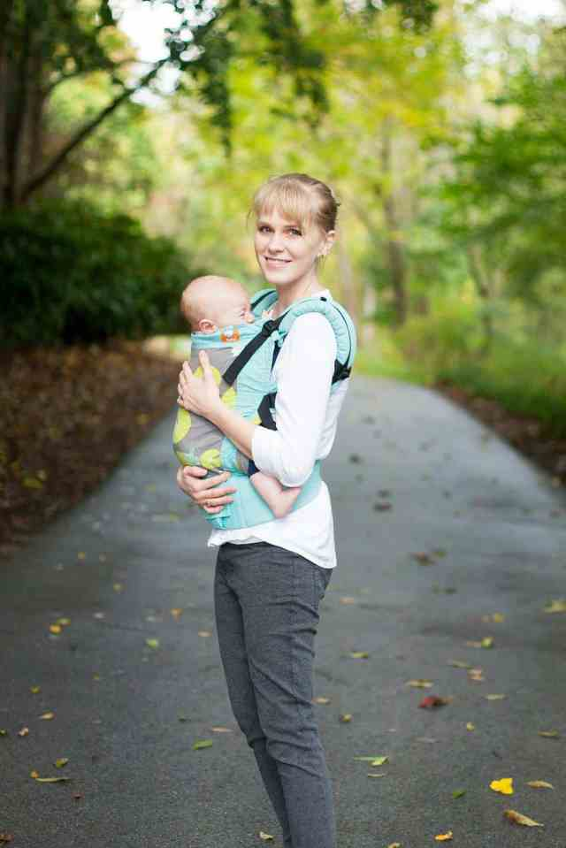 mom-smiling-on-ath-wearing-baby-in-tula-baby-wrap