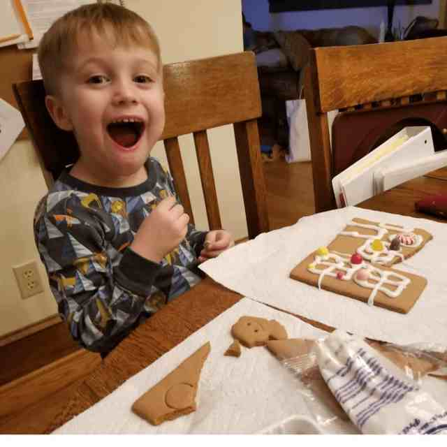 toddler-boy-with-huge-grin--making-gingerbread-cookies