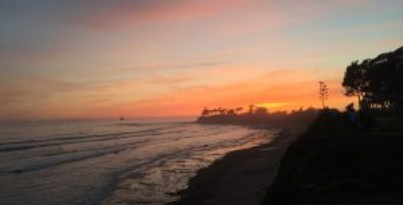 Taking a walk and enjoying the astonishing view of sunset at Sands Beach, Isla Vista